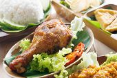 stock photo of ayam  - Popular Indonesian local food nasi ayam penyet - JPG