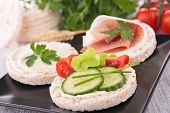 stock photo of canapes  - canape with rice cake and cucumber - JPG