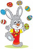 picture of cony  - Little rabbit juggling with colorful Easter eggs - JPG