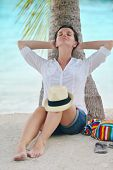 beautifel and happy woman girl on beach have fun and relax on summer vacation  over the beautiful tr
