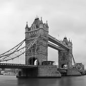 Tower Bridge black and white in London over Thames River as the famous landmark.
