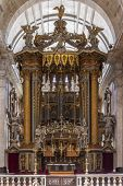 Lisbon, Portugal - September 15, 2013: Baroque altar under baldachin. Church of the Sao Vicente de F