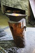 stock photo of anvil  - Hot anvil in the forge in Toledo close up - JPG