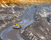 image of iron ore  - Dump trucks and roads to deliver ore and auxiliary cargo career on extraction of iron ore - JPG