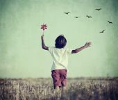 picture of grass bird  - Retro image of happy cheerful carefree kid in nature - JPG
