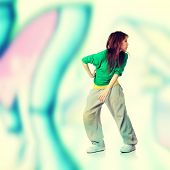 Modern dancer,  against abstract grafitti background
