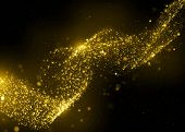Gold glittering stars dust spiral background. Gold sparkle glitter background. Glitter stars backgro