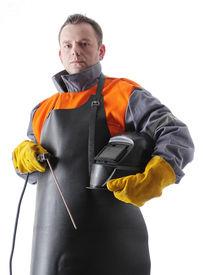 stock photo of tig  - Portrait of welder wearing protective welding black leather apron - JPG
