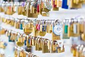 stock photo of lost love  - Lockers at the bridge symbolize love for ever - JPG