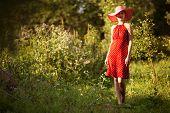 image of beatitudes  - Happy woman in a hat walks barefoot - JPG
