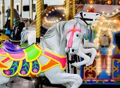 stock photo of carousel horse  - A close up of a horse on a carousel at an amusement park - JPG