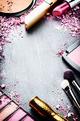 foto of cosmetic products  - Frame with various makeup products in pink tone - JPG