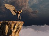 image of cliffs  - Man with artificial wings about to jump off a cliff - JPG