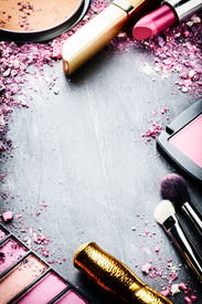 image of cosmetic products  - Frame with various makeup products in pink tone - JPG