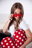 picture of flirty  - Portrait of a Flirty Woman In Heart Shaped Glasses - JPG