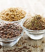 foto of flax seed  - Bowls of whole and ground flax seed or linseed - JPG