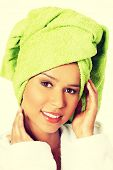 stock photo of turban  - Attractive spa woman wrapped in towel with turban on head - JPG