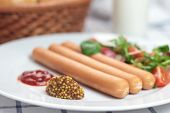 foto of wieners  - Wiener sausage with ketchup mustard and salad - JPG