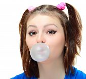 stock photo of lolita  - Beautiful young lady blowing big bubble gum on white background  - JPG