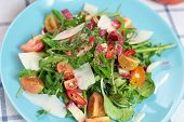 picture of rocket salad  - Plate of fresh tomato rocket chicory and sheep