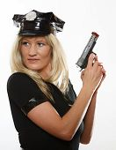 stock photo of cap gun  - blonde female policewoman cop posing with gun handgun isolated on white background - JPG