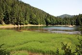 stock photo of gory  - Beautiful wild lake in the mountains  - JPG
