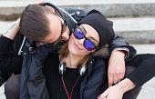foto of cuddle  - Beautiful young stylish couple loving and cuddling - JPG