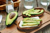 stock photo of sandwich  - sandwich of rye bread with avocado and goat cheese  - JPG