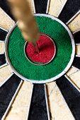 foto of bullseye  - closeup of a Dartboard with Steeldarts in bullseye - JPG