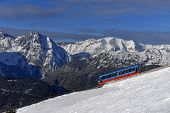 stock photo of snowbird  - trailer for lifting skiers in the Alps - JPG