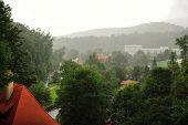 stock photo of bohemia  - Beautiful historical town Cesky Krumlov in South Bohemia in the rain - JPG