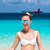 picture of hydroplanes  - Woman in bikini at tropical beach - JPG
