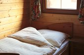 stock photo of chalet  - Bedding sheets and pillow on bed at new chalet - JPG