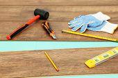 stock photo of laminate  - Carpenter tools on new laminate floor - JPG