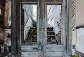 stock photo of wooden door  - Broken wooden doors at abandoned building in Jerome Arizona - JPG