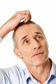 stock photo of scratching head  - Mature confused man scratching his head - JPG