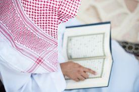 picture of muslim man  - Young Arabic Muslim man reading Koran and praying - JPG