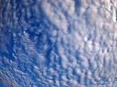 picture of distort  - Dense and stratus clouds against the blue sky with wide angle fisheye lens and distortion view - JPG