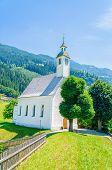 foto of bavarian alps  - Beautiful alpine landscape with typical white high alpine church - JPG