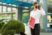 picture of shiting  - Stylish business woman in the city street