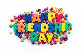 stock photo of friendship day  - happy friendship day word in colorful stones - JPG