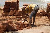 stock photo of rickshaw  - The Indian man works at building - JPG