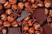 foto of hazelnut  - Chocolate star anise and hazelnuts as background - JPG