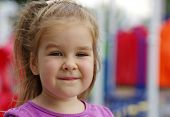 pic of little young child children girl toddler  - Portrait a little girl on playground - JPG