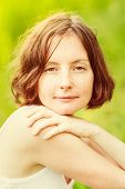 foto of freckle face  - Outdoor portrait of lovely freckled young woman who hugging herself and looking at camera - JPG