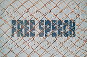 stock photo of taboo  - Concept about the rights to free speech with text written under a wire fence - JPG
