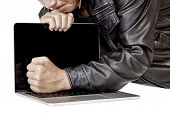 foto of reboot  - Angry leather business man breaking computer laptop on white background - JPG