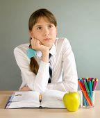 picture of schoolgirl  - schoolgirl sitting at a desk in the classroom - JPG