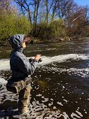 picture of fisherman  - Fisherman with spinning in his hand - JPG