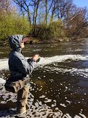 pic of fisherman  - Fisherman with spinning in his hand - JPG
